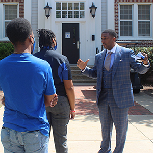 Chancellor at dorm with students