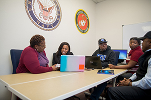 Student uses laptop for online classes