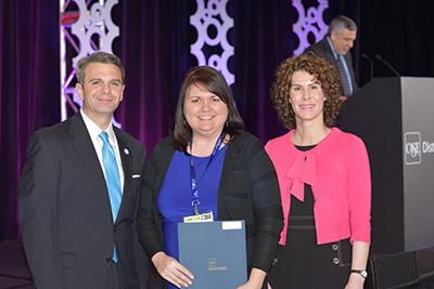 Misty McMillan receives award from CASE representatives in Atlanta.