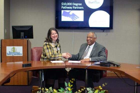 Chancellor James A. Anderson of Fayetteville State University and Dr. Katherine Allen, Vice President of Instruction at Blue Ridge Community Collee sign the $10 K Degree Pathway Agreement at the Partners Convening on April 1.
