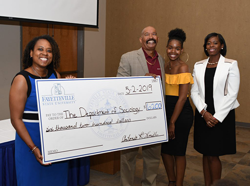 Father presents check to Department of Sociology