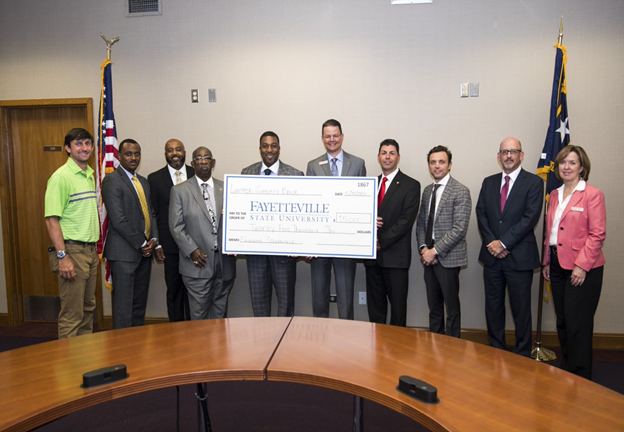 Lumbee Guaranty Banka and FSU officials with check